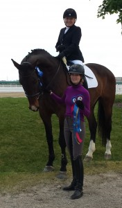 Lara Oles on Bella along with her trainer, Annie Sweet